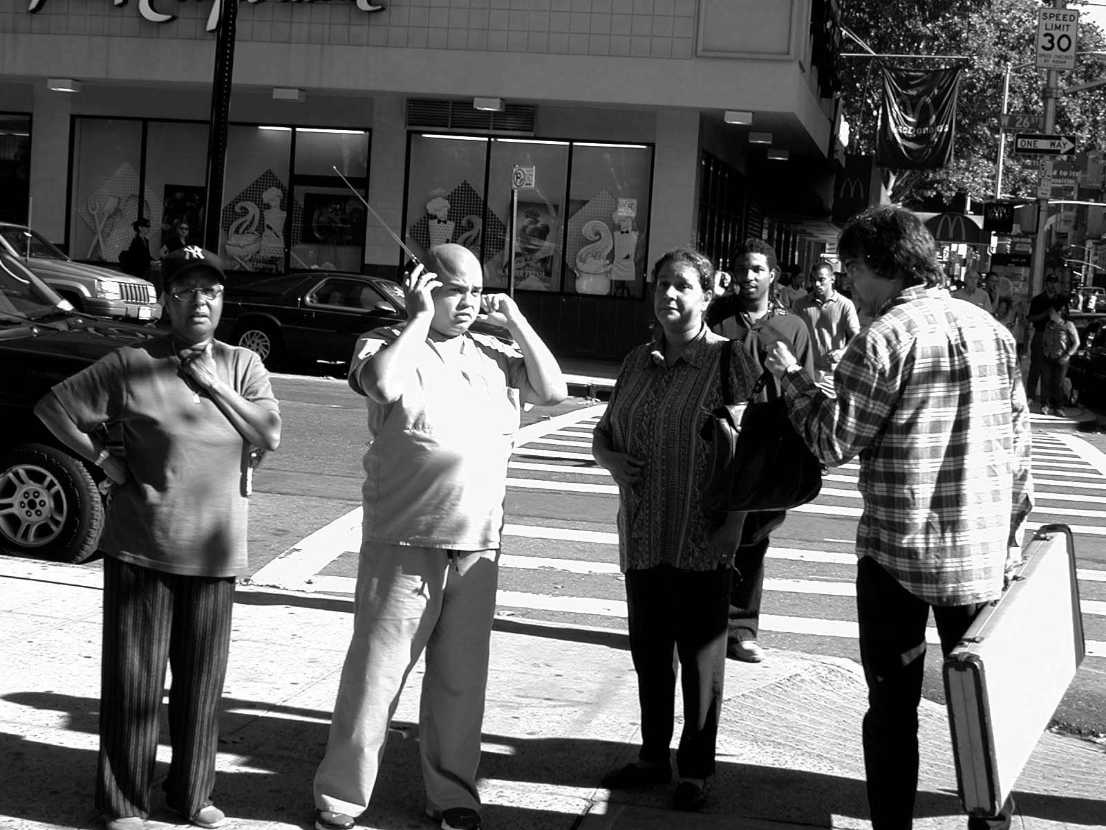 015 - 10AM - 8th Ave at 26th St. - onlookers and a man yelling