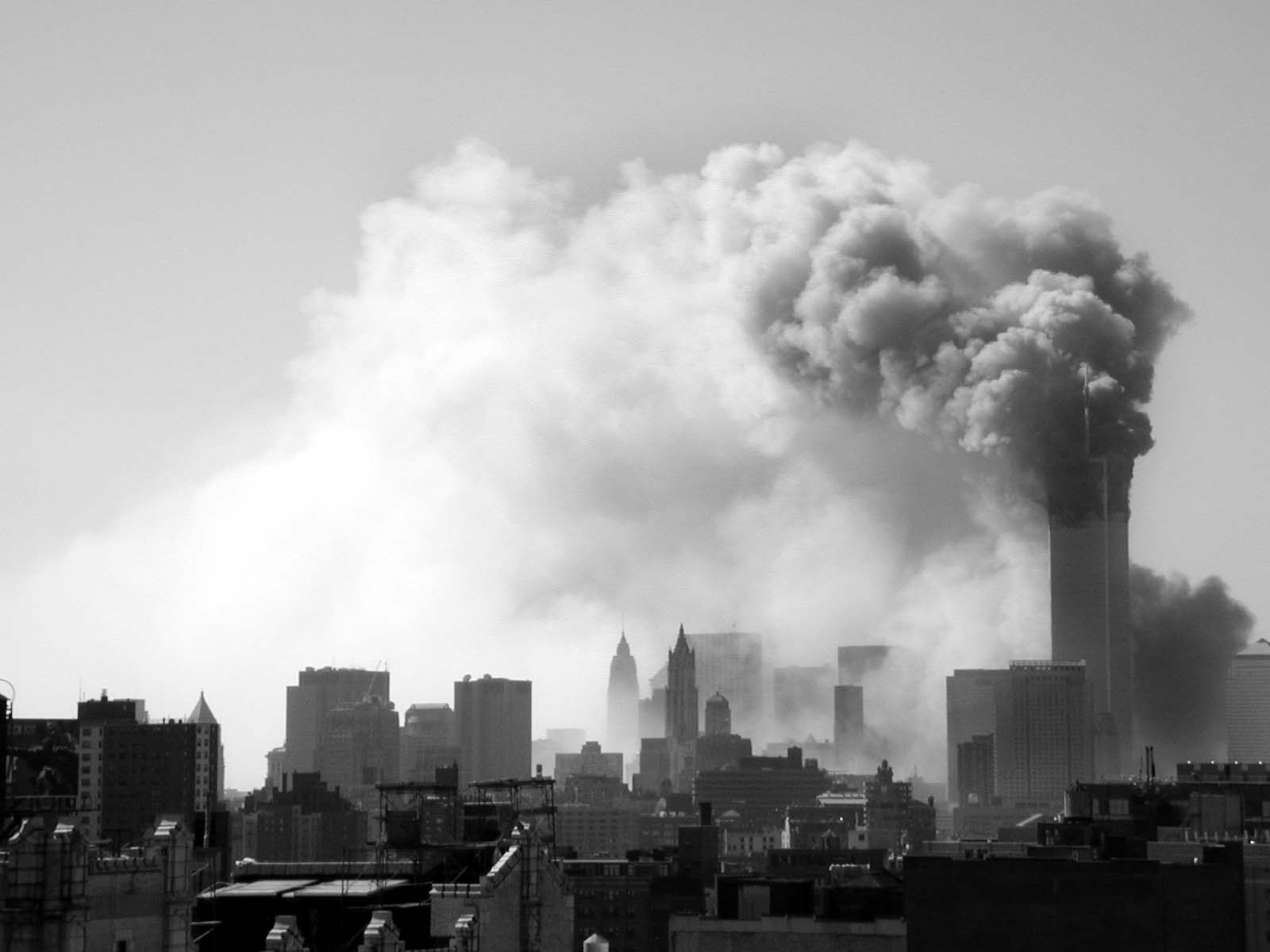 021 - 10.20AM - north tower burning, trail of smoke to the east