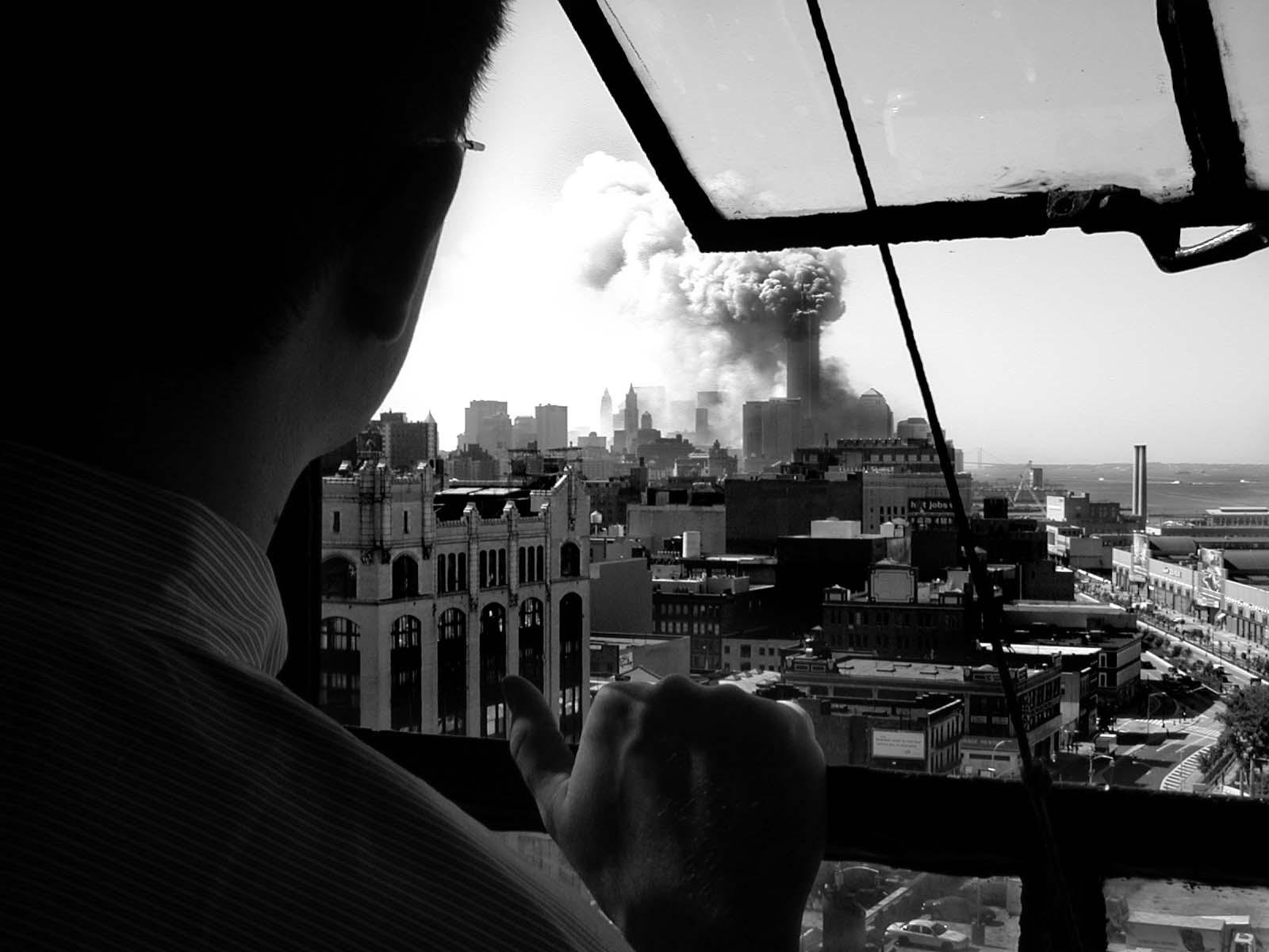 022 - 10.20AM - man watching north tower burning