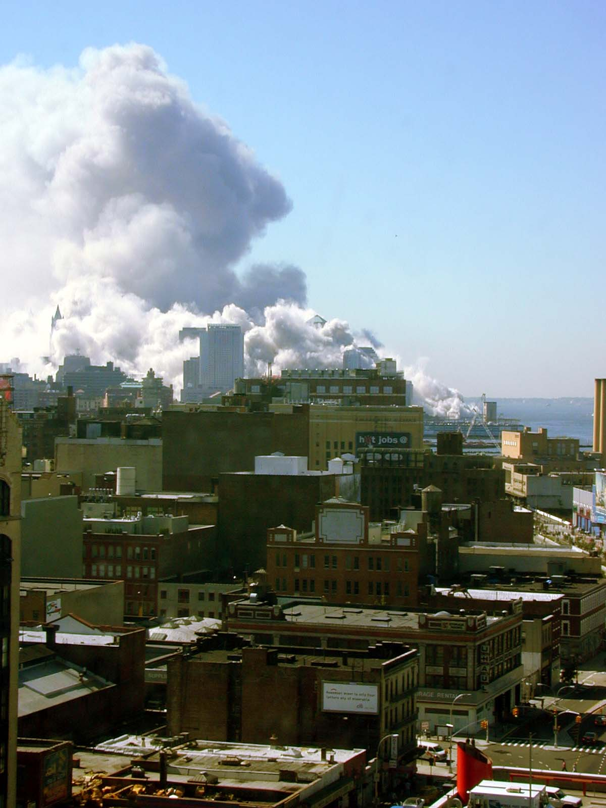 026 - 10.30AM - both towers gone, a plume a smoke