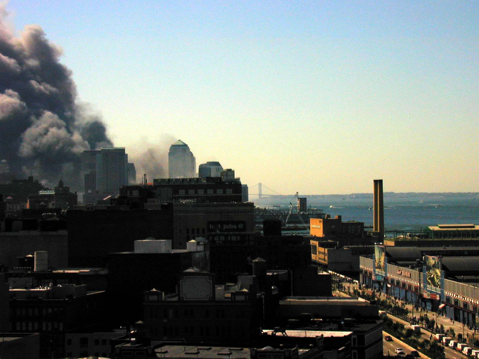 032 - 10.35AM - a thick dark plume of smoke, ambulances head down the west side highway