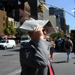 048 - 12.15PM - 7th Ave at 25th st. - a makeshift hat