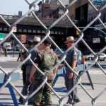 089 - Thu 1PM - highway patrol and national guard blocking the street