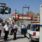 103 - Thu 1PM - ambulance drivers waiting for orders in front of a collatoral damage billboard
